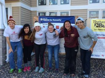 A few of our members volunteering at Habitat for Humanity!
